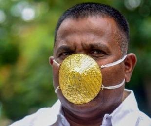 foto: Coronavirus: un empresario indio usa un tapabocas de oro macizo